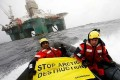 Greenpeace Head Arrested on Cairn Oil Rig in Greenland