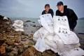 Typhoon Dumps Tons of Plastic Pellets on Hong Kong Beaches