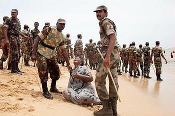 India police beat woman