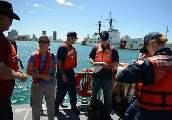 U.S. Coast Guard members prepare to sample Honolulu Harbor in wake of molasses spill (Photo courtesy U.S. Coast Guard)