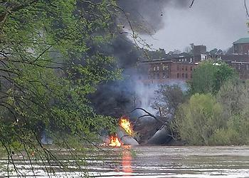 Flames and smoke on the bank of the James River at Lynchburg, Virginia after an oil train explosion, April 30, 2014 (Photo by Waterkeeper Alliance)