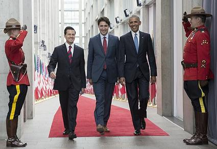 PHOTO: The three North American leaders enter the conference hall in Ottawa, from left, President Enrique Peña Nieto, Prime Minister Justin Trudeau and President Barack Obama, June 29, 2016. (Photo courtesy The White House)